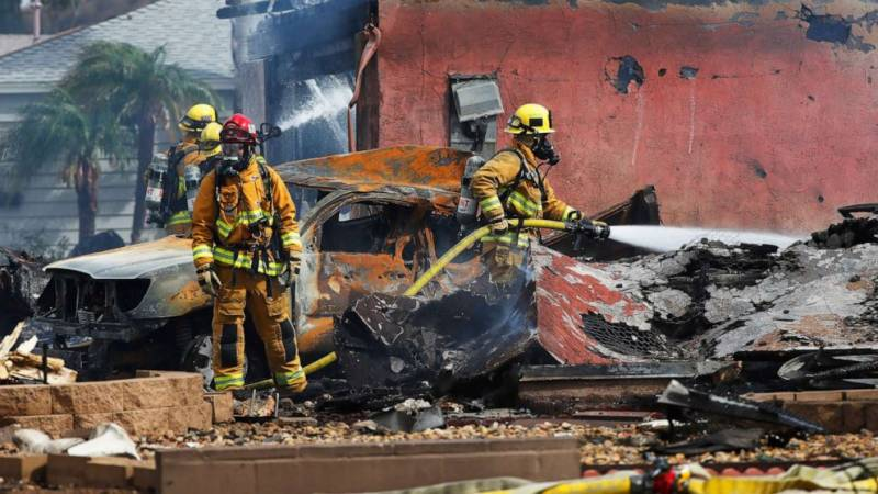 Two dead as small plane crashes on houses in US