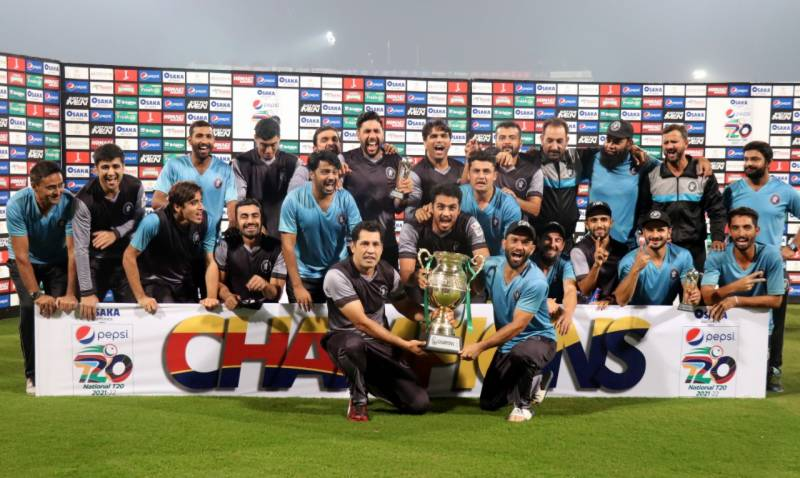 Khyber Pakhtunkhwa players and support staff pose with National T20 trophy