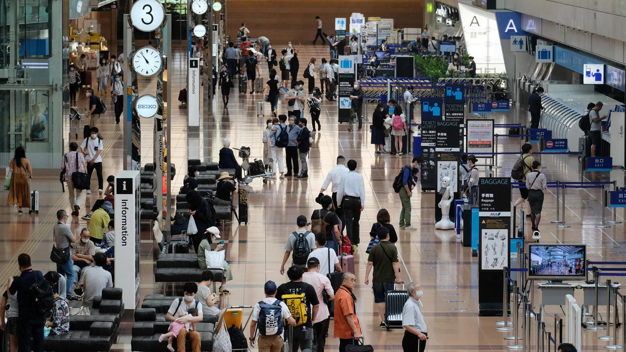 Japan says to lift foreigner re-entry ban